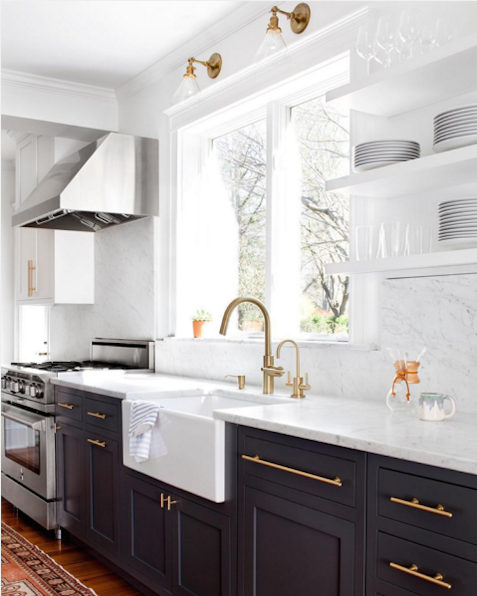 navy cabinetry with brass hardware kitchen