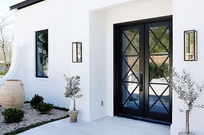 front door of white brick home