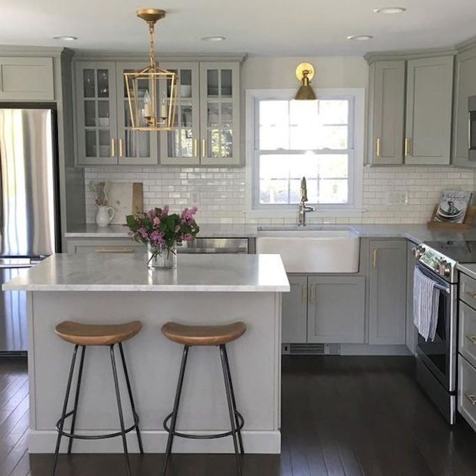 gray, white and brass kitchen