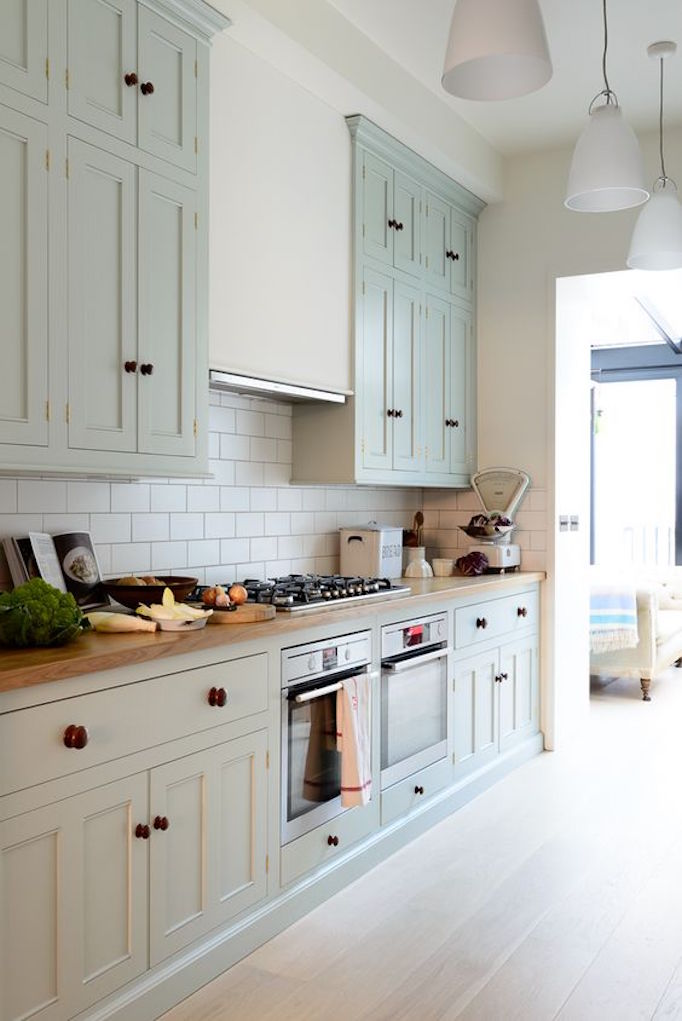 kitchen with green gray cabinets
