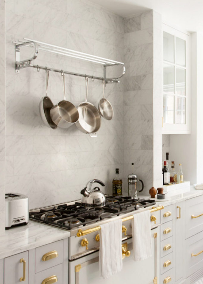 marble black and brass kitchen stove detail