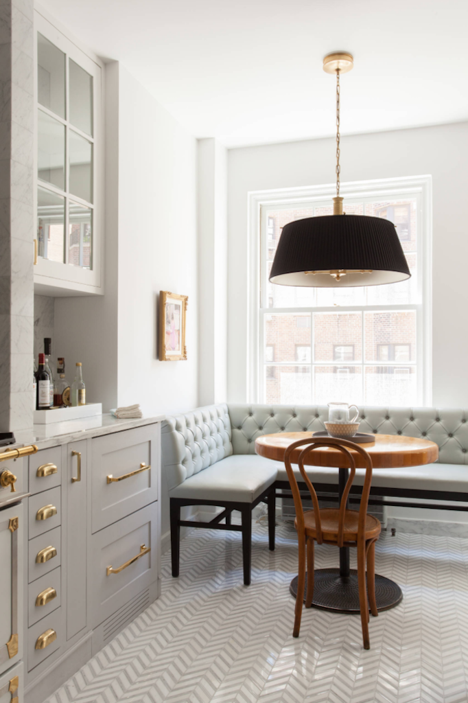 marble black and brass kitchen with drum pendant in breakfast nook