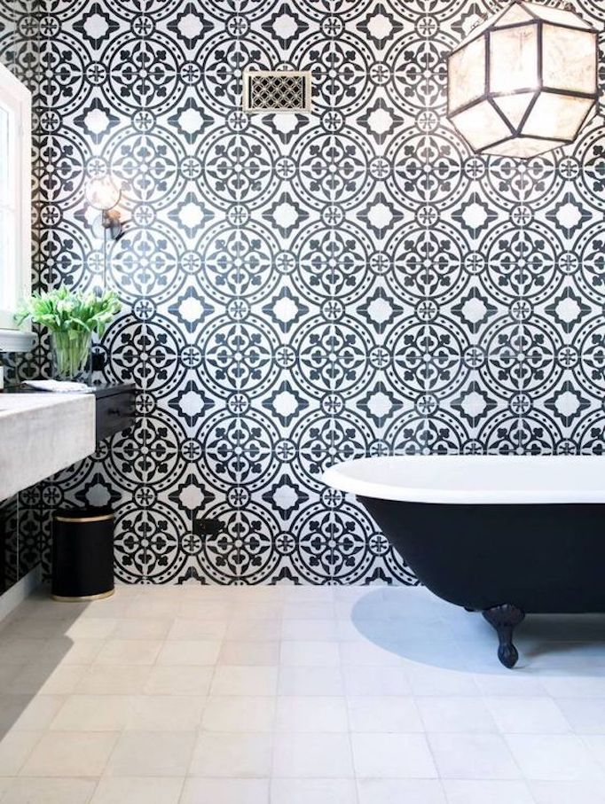 black and white cement tiles look beautiful on farmhouse floors but taking them up a wall puts them on display as a work of art so pretty